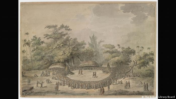 A grouping of huts with crowds gathered around them on an island. (The British Library Board)