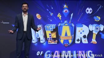 At Gamescom 2018, Felix Falk stands before a colorful drawing reading Heart of Gaming (picture-alliance/CITYPRESS 24/Krick)