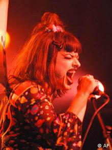 Nina Hagen screaming into the microphone during a concert