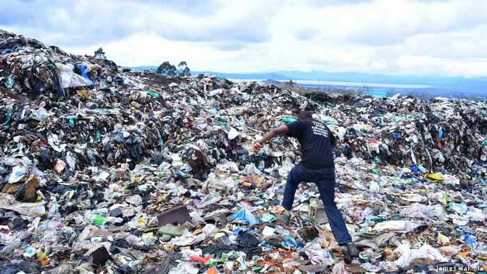 A sprawling waste site littered with plastic