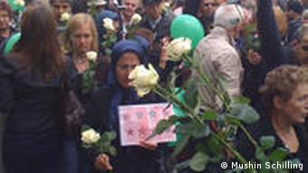 Crowd carrying white roses for Iran protestors