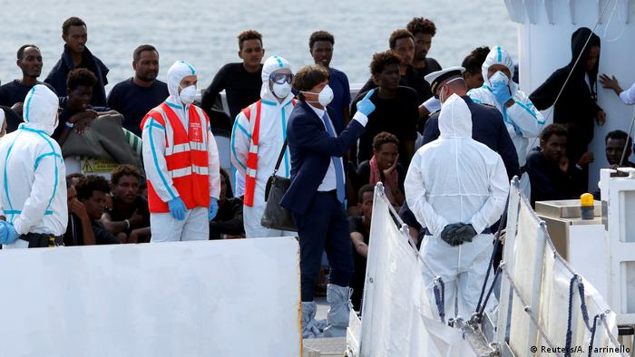 Migrants and authorities on board the Diciotti rescue ship in the Sicilian port of Catania