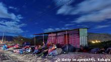 Venezuelan migrants on their way to Peru sleep along the Pan-American Highway between Tulcan and Ibarra in Ecuador, after entering the country from Colombia, on August 22, 2018. - Ecuador announced on August 16 that Venezuelans entering the country would need to show passports from August 18 onwards, a document many are not carrying. And Peru followed suit on August 17, announcing an identical measure due to begin on August 25. (Photo by Luis ROBAYO / AFP) (Photo credit should read LUIS ROBAYO/AFP/Getty Images)