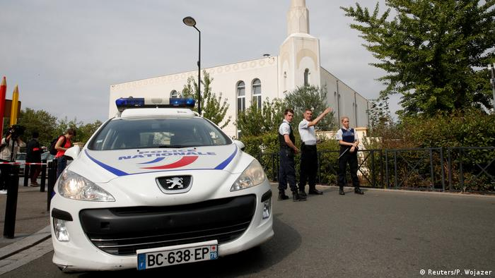 French police secure a street in Trappes after the attack
