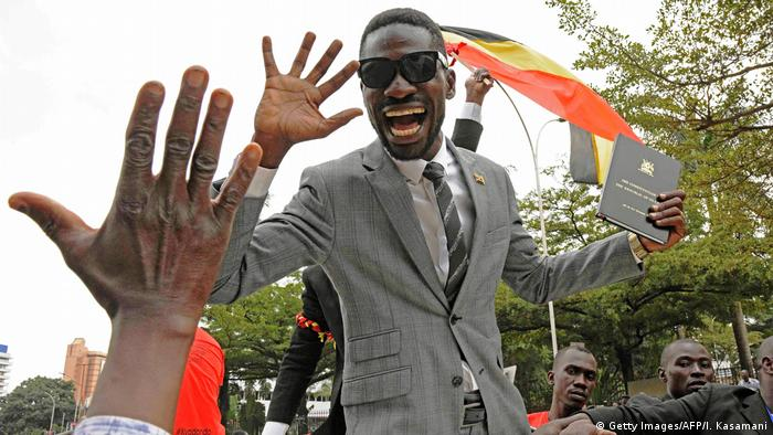 Bobi Wine waving to supporters after becoming an MP