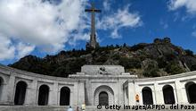 People visit the Valle de los Caidos (The Valley of the Fallen), a monument to the Francoist combatants who died during the Spanish civil war and Spain's General Francisco Franco´s final resting place on July 03, 2018 in San Lorenzo del Escorial, near Madrid. - A 150-metre-high cross on top of a basilica carved into a mountain by political prisoners...and lots of fresh flowers. Welcome to the tomb of Francisco Franco in the Valley of the Fallen, a divisive monument from where the remains of Spain's late dictator could soon be exhumed. (Photo by OSCAR DEL POZO / AFP) (Photo credit should read OSCAR DEL POZO/AFP/Getty Images)