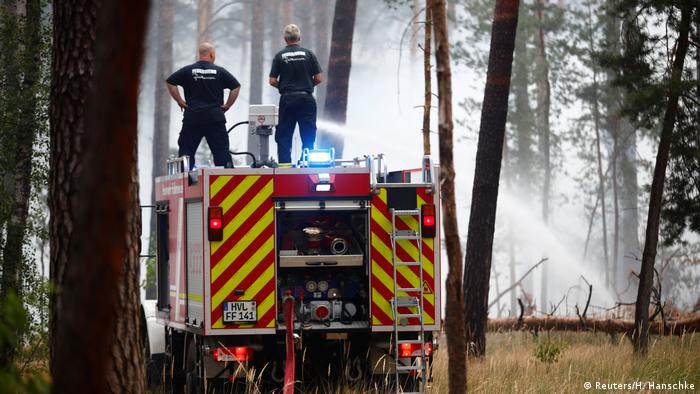 Firefighters put our forest fires outside of Berlin in the German state of Brandenburg (Reuters/H. Hanschke)