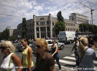 People pass by the University of Belgrade Law School building in central Belgrade, Serbia, on July 8, 2009. (Copyright Petar Labrador)