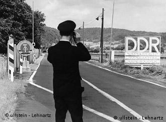 A border guard at the former East-West German border zone at Herleshausen-Wartha