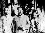 Communist Chinas number one Communist Mao Tse Tung poses with his guests The Panchen Lama and The Dalai Lama during their visit to the red capital in more peaceful days 1956 / Mono Print