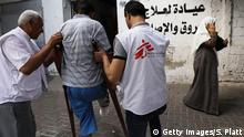 13.05.2018 GAZA CITY, GAZA - MAY 13: A man who was shot in his leg during protests at the Gaza/Israel border fence enters a medical clinic operated by Medecins Sans Frontieres/Doctors Without Borders (MSF) on May 13, 2018 in Gaza City, Gaza. The international humanitarian medical non-governmental organisation (NGO) has treated over 700 gunshot wounds alone since the protests against Israel started last month. Tensions are high along the Gaza-Israel border following more than a month of weekly mass protests near the fence that has left 40 Palestinian protesters killed and over 1,700 wounded by Israeli army fire. Gaza's Hamas rulers have vowed that the marches will continue until the decade-old Israeli blockade of the territory by is lifted. Anticipation is building to a massive protest on May 15, the day Palestinians mark the nakba or catastrophe, to commemorate the anniversary of their mass uprooting during the 1948 war over Israel's creation. (Photo by Spencer Platt/Getty Images)
