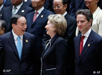 Vice Premier Wang Qishan, left, laughs with Secretary of State Hillary Rodham Clinton as they pose for the family photo at the start of the U.S.-China Strategic and Economic Dialogue in Washington, Monday, July 27, 2009. Right is Treasury Secretary Timothy Geithner and far left is Chinese State Councilor Dai Bingguo. (AP Photo/Gerald Herbert)