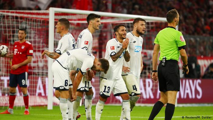 Hoffenheim remonstrate with the referee during their loss to Bayern Munich. (Reuters/M. Dalder)