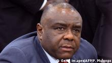 Former DRCongo warlord Jean-Pierre Bemba looks on as he arrives at Kinshasa airport on August 1, 2018, after more than 11 years abroad -- a decade of it behind bars. - Bemba returned home on August 1, 2018 to huge crowds and police firing teargas, reflecting the country's high-voltage political mood. Bemba, 55, throwing down the gauntlet to his rival President Joseph Kabila, has vowed to contest twice-delayed elections due to take place on December 23. (Photo by Papy MULONGO / AFP) (Photo credit should read PAPY MULONGO/AFP/Getty Images)