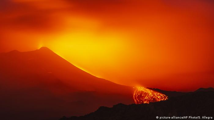Streams of lava run down the slopes of Mount Etna