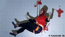 Sport Climbing – 2018 Asian Games – Women's Speed, Semifiinals – JSC Sport Climbing, Palembang, Indonesia – August 23, 2018 – Susanti Rahayu Aries of Indonesia reacts after winning. REUTERS/Edgar Su