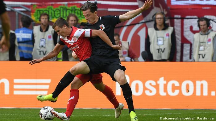 Marcel Sobottka tackling the ball away from Michael Gregoritsch