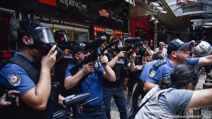 Police in riot gear disperse protesters