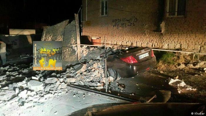 A car flattened by debris
