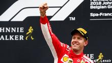 Formula One F1 - Belgian Grand Prix - Spa-Francorchamps, Stavelot, Belgium - August 26, 2018 FerrariÕs Sebastian Vettel celebrates on the podium after winning the race REUTERS/Francois Lenoir