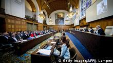27.08.2018 +++ A remembrance for Kofi Annan, former Secretary-General of the United Nations who passed away on August 18, 2018 is displayed on a screen during the opening of case between Iran and the United States at the The International Court of Justice (ICJ) in the Hague, August 27, 2018. - Iran opened a lawsuit demanding the UN's top court order the suspension of renewed US sanctions which it says are devastating its economy. (Photo by Jerry Lampen / ANP / AFP) / Netherlands OUT (Photo credit should read JERRY LAMPEN/AFP/Getty Images)
