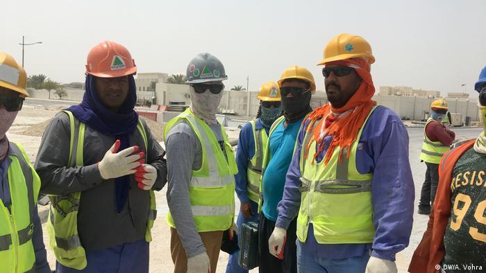 Asiatische Bauarbeiter in Katar