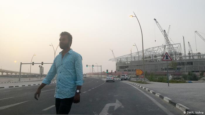 A guest worker outside Al Reyan stadium in Qatar