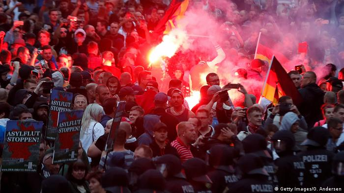 Right wing demonstrators light flares on August 27, 2018 in Chemnitz, eastern Germany, following the death of a 35-year-old German national who died in hospital after a dispute between several people of different nationalities, according to the police