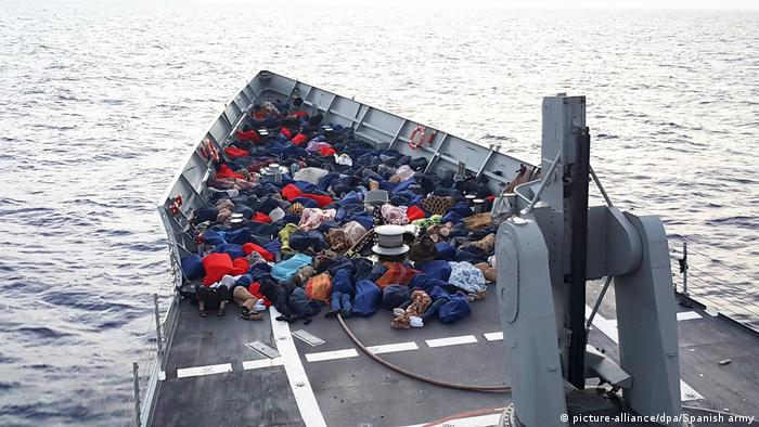 Rescued migrants on a boat