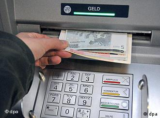 A man withdraws cash from a machine