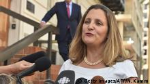 28.08.2018 Canadian Foreign Minister Chrystia Freeland speaks to the media August 28, 2018 in Washington, DC. - Freeland arrived in Washington to rejoin trilateral trade negotiations, after interrupting a trip to France, Germany and Ukraine. (Photo by Nicholas Kamm / AFP) (Photo credit should read NICHOLAS KAMM/AFP/Getty Images)