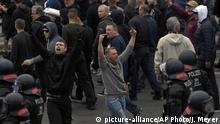 27-08.2018 Men shout during a far-right protest in Chemnitz, Germany, Monday, Aug. 27, 2018 after a man has died and two others were injured in an altercation between several people of various nationalities in the eastern German city of Chemnitz on Sunday. (AP Photo/Jens Meyer) |