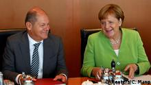 German Chancellor Angela Merkel and Finance Minister and vice-chancellor Olaf Scholz wait for the start of the weekly cabinet meeting at the Chancellery in Berlin, Germany, August 29, 2018. REUTERS/Christian Mang