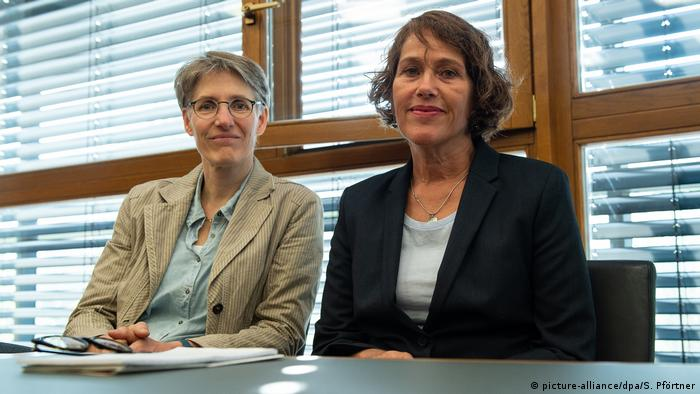 Doctors Natascha Nicklaus and Nora Szasz appear in court in Kassel, Germany
