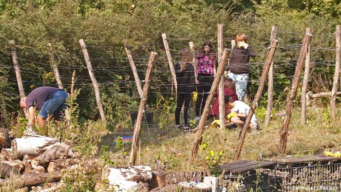 Photo: Frames for growing vines, children in the background
