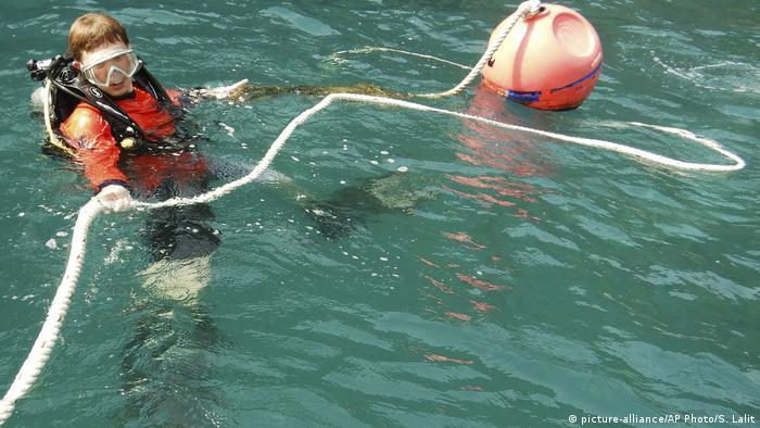 A diver establishes a float rope at Maya Bay