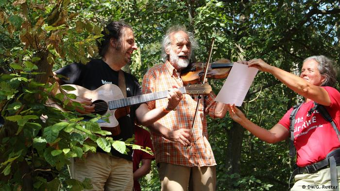 Hambach forest protesters playing instruments