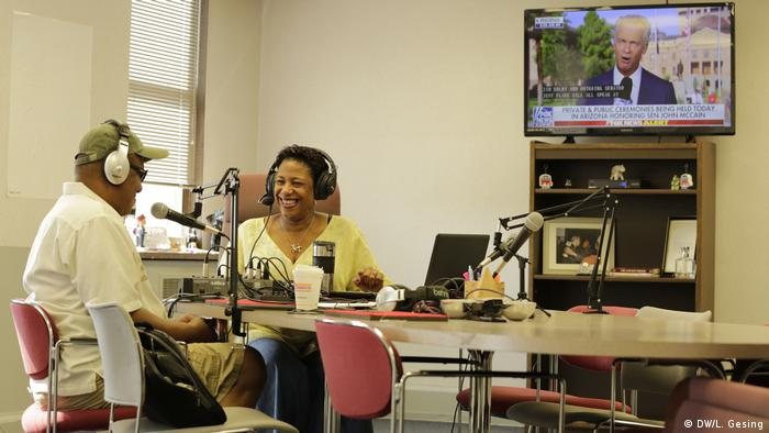 A radio host talking to a guest