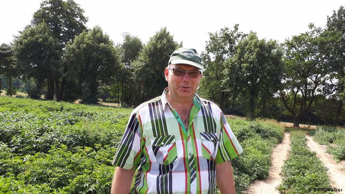 Farmer Hans-Heinrich Grünhagen stands in front of one of his fields