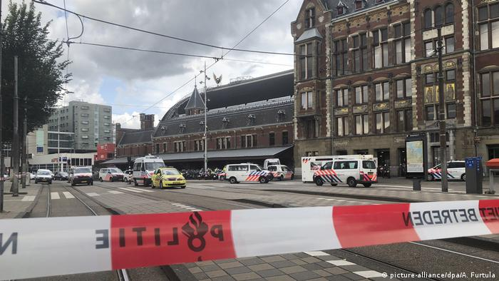 A police tape closing off the street in front of Amsterdam's main station