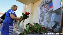 01.09.2018+++Donezk, Ukraine+++ A woman places flowers to commemorate the leader of the separatist self-proclaimed Donetsk People's Republic Alexander Zakharchenko, who was assassinated in Donetsk, in Simferopol, Crimea September 1, 2018. REUTERS/Pavel Rebrov