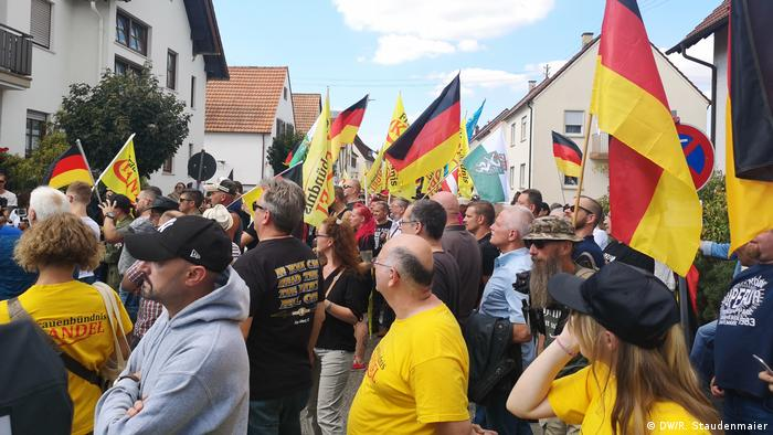 Protesters listen to a speech during the right-wing protest in Kandel, Germany