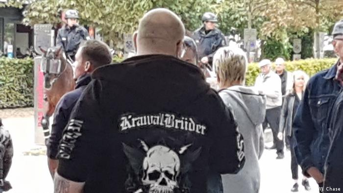 Far-right demonstrator from the back with skull on jacket