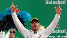 02.09.2018 +++ Formula One F1 - Italian Grand Prix - Circuit of Monza, Monza, Italy - September 2, 2018 Mercedes' Lewis Hamilton celebrates on the podium after winning the race REUTERS/Stefano Rellandini
