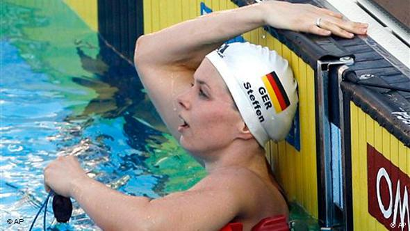 Germany's Britta Steffen reacts after winning a Women's 100m Freestyle final, at the FINA Swimming World Championships, in Rome, Friday, July 31, 2009. (AP Photo/Alessandra Tarantino)