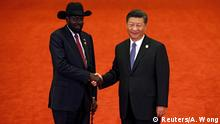 South Sudan President Salva Kiir Mayardit, left, shakes hands with Chinese President Xi Jinping during the Forum on China-Africa Cooperation held at the Great Hall of the People in Beijing, September 3, 2018. Andy Wong/POOL Via REUTERS