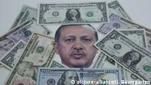 GERMANY, BONN - AUGUST 18: Symbol photo on the topics Turkish Lira, lira devaluation, USA sanctions, public debt, etc. Portrait of the Turkish President Recep Tayip Erdogan, framed by US dollar banknotes. | Keine Weitergabe an Wiederverkäufer.