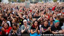 People react as they wait for an open air anti-racism concert in Chemnitz, Germany, September 3, 2018. REUTERS/Hannibal Hanschke