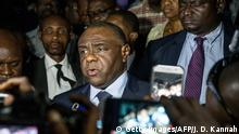 Congolese opponent Jean-Pierre Bemba (C), speaks to the press after applying to be a candidate for next presidential elections of December 23, at the office of the Independent Electoral Commission, in Kinshasa, on August 2, 2018. - Congolese opposition leader Jean-Pierre Bemba announced August 2, 2018 in Kinshasa that he had applied to be a candidate for the presidential election of December 23, the day after his return to the Democratic Republic of Congo, after ten years spent in the prisons of the ICC. (Photo by Junior D. KANNAH / AFP) (Photo credit should read JUNIOR D. KANNAH/AFP/Getty Images)