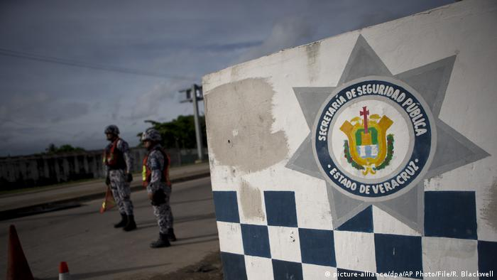 Veracruz state police stand at roadblock along the highway